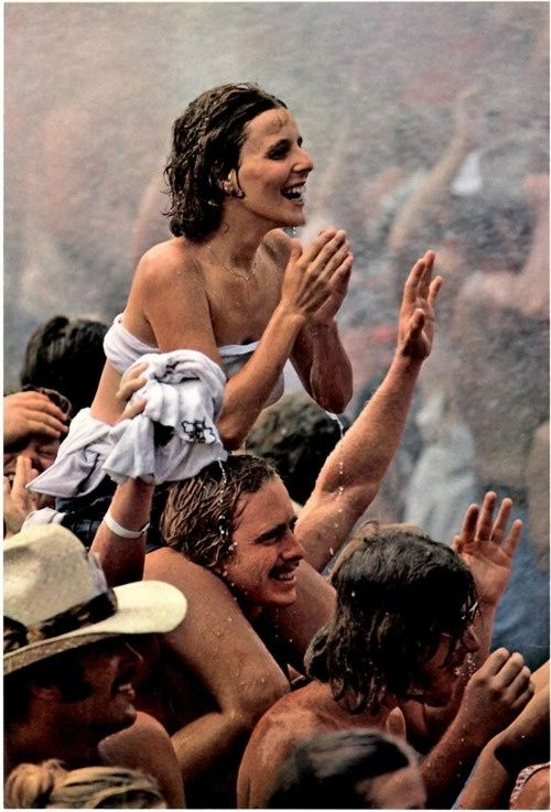 """22 Woodstock Photos That Make You Feel Like You Were There - Packed Performance  Advertised as a """"weekend in the country,"""" the outdoor festival saw wet weather, mud baths, and technical delays due to rain."""