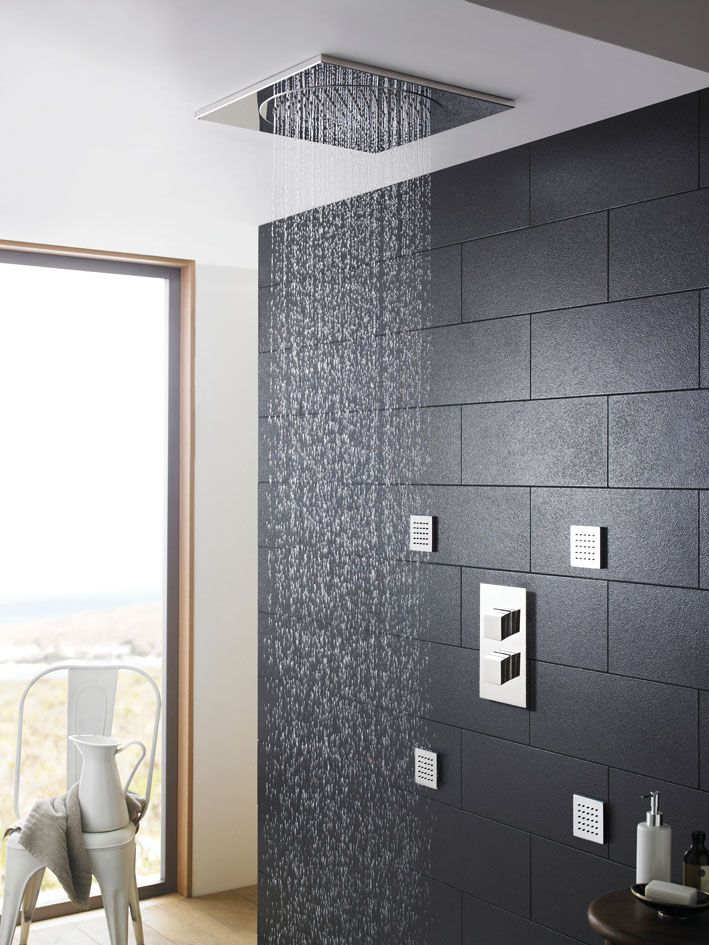 A ceiling mounted shower head gives a real feeling of luxury and indulgence.  This tile style head has a low profile and co-ordinates with the square shower controls.