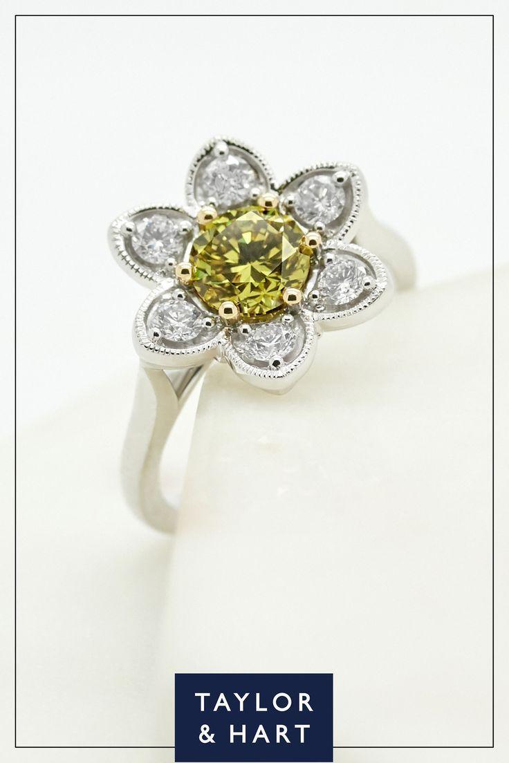 A #bespoke #diamond set #daisy #halo #engagement #ring with #milgrain #details.