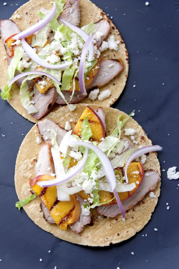 Orange Pork Tacos with Grilled Peaches - Muy Bueno Cookbook  Rather than garnishing tacos with orange segments I addedgrilled peaches. We are eating peaches like crazy this summer and wanted to try them as a garnish on a savory dish, and so glad I did. This citrus flavored pork is perfectly complemented by the sweet grilled peaches.