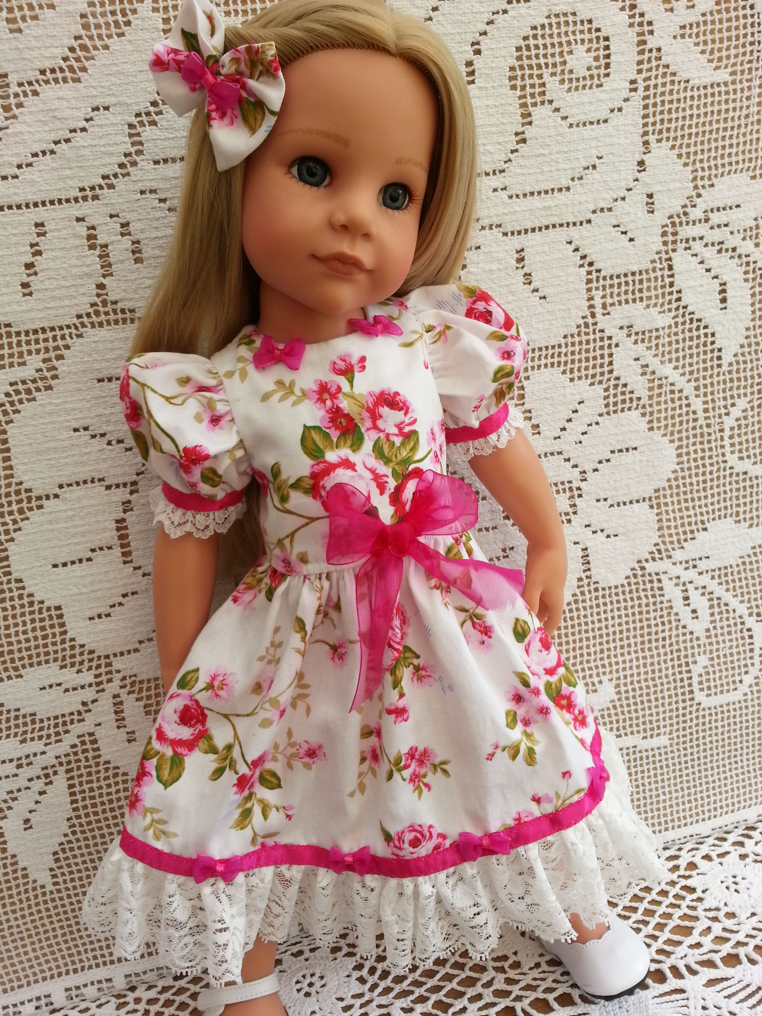 Hannah Gotz in a lovely soft flowing rose dress with floaty lace hem & organza bows