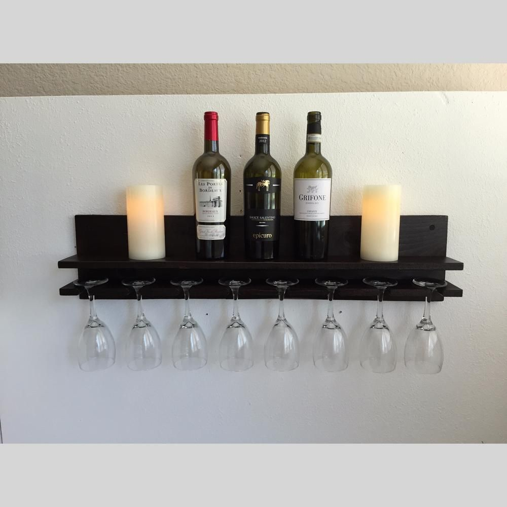 This shelf and glasses rack is an elegant choice that brings taste and beauty to your home decor and will complement any bar or kitchen area.