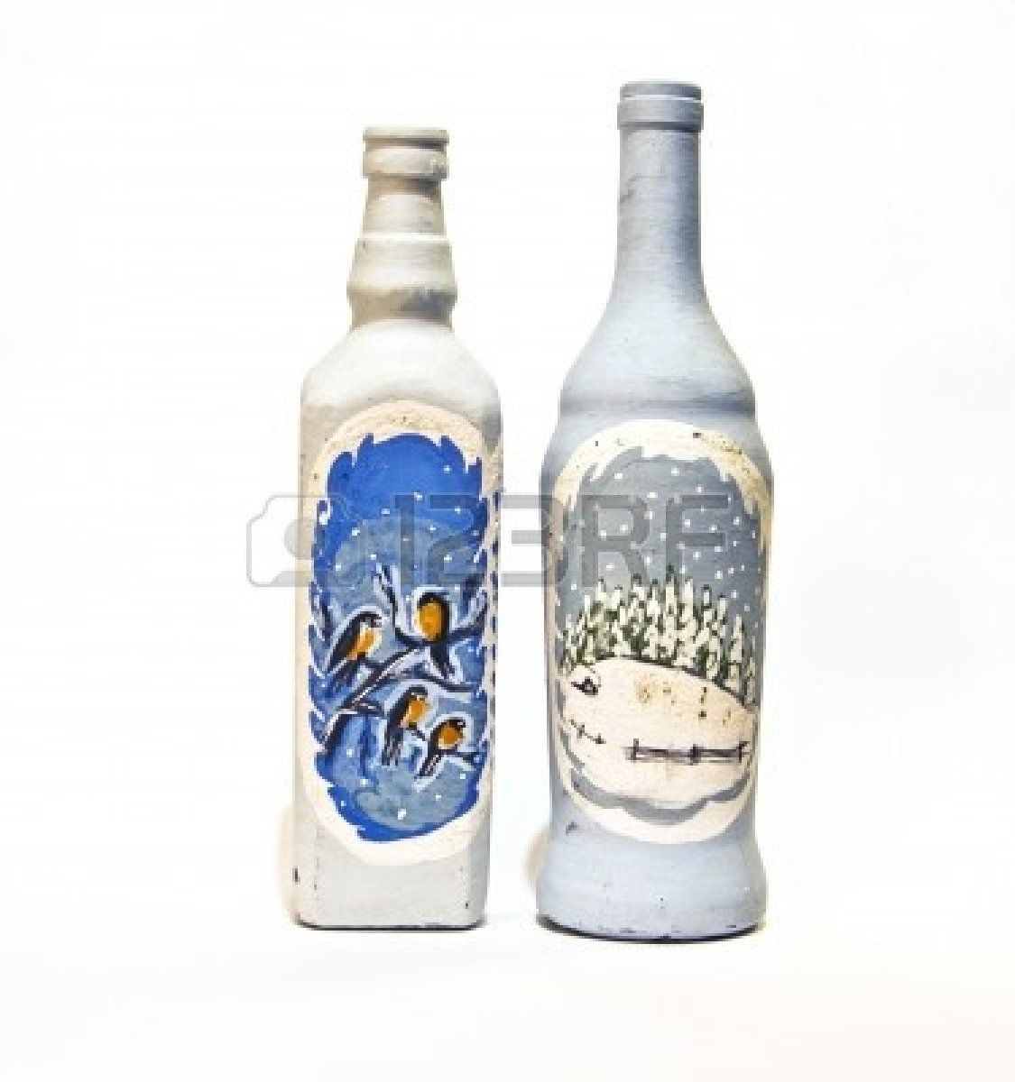 Two bottles hand painted with pictures of winter landscapes.