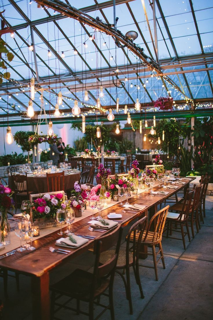 the glass house, the hanging light bulbs make the wedding decoration and there ...