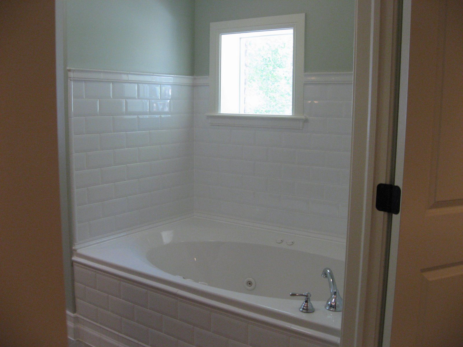 might want to use white subway tile around the master bath tub, like ...