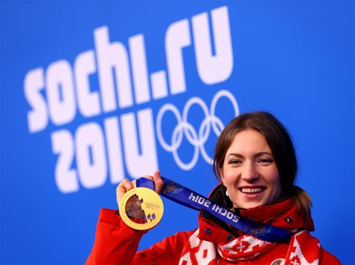 Gold medalist Darya Domracheva of Belarus celebrates during the medal ceremony for the Women's 12.5 km Mass Start on day 12 of the Sochi 2014 Winter Olympics at Medals Plaza