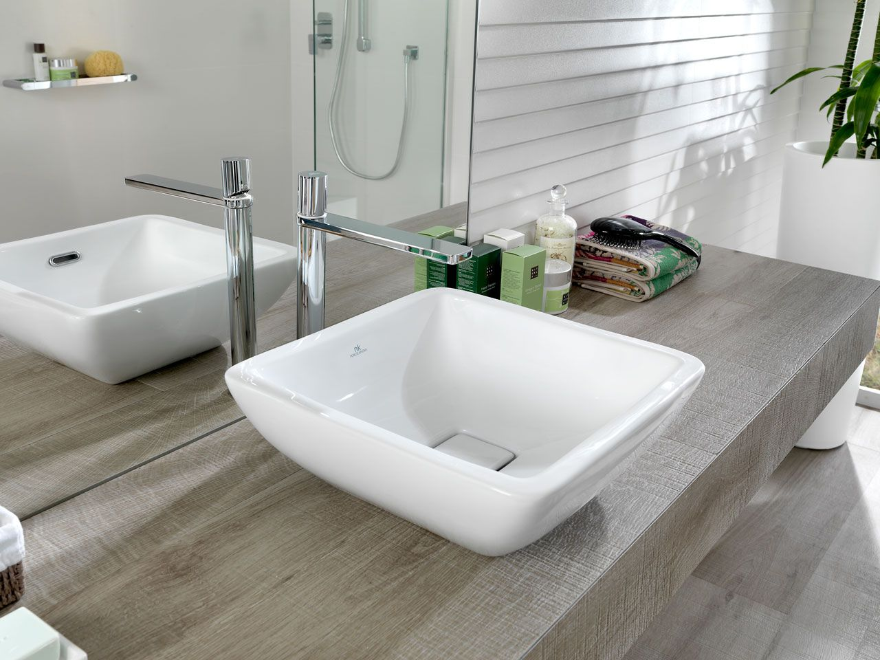 lavabo cuadrado sobre encimera porcelanosa ba o