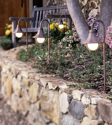 The secrets to fabulous outdoor lighting walkways planting and paths high impact a string of low voltage lighting is the perfect solution for brightening a shady bend along a walkway its a low cost easy do it yourself aloadofball Images