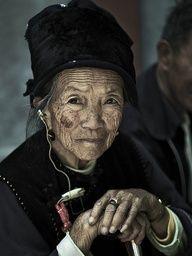 Old  woman, Yunnan, China by Eric Lafforgue