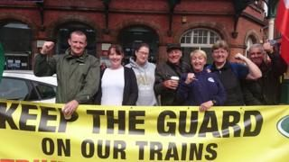 "RMT members at Northern Rail and Greater Anglia strike -  RMT members at Northern Rail and Greater Anglia strike  9 May 2018                  Image copyright                  Pat DraperImage caption                      RMT union members on the picket line outside Wigan Wallgate Station  Workers at two train companies have walked out again in a dispute over the role of guards.  Rail Maritime and Transport union (RMT) members at train operators Northern Rail and Greater Anglia have staged a 24-hour strike.  The union argues passenger safety would be put at risk by getting rid of guards and extending driver-only services.  Greater Anglia said it was running a normal service but Northern services have been affected.  Northern said a majority of its services would run between 07:00 and 19:00 BST but ""many routes will start to wind down from late afternoon"".  RMT general secretary Mick Cash said: ""It is ludicrous that we have been able to negotiate agreements in Wales and Scotland that lock in the guard guarantee but we are being blocked from reaching the same settlement across the North and Greater Anglia.""                   Image copyright                  RMTImage caption                      Rail workers at a picket line in front of a Norwich train station  Northern said driver-only trains are widely used elsewhere.   The company added: ""We are still prepared to offer unprecedented guarantees of jobs and pay reviews until the end of our franchise in 2025 with the government guaranteeing jobs beyond that but both guarantees depend on RMT ending its strike action.""  Greater Anglia said it wanted to employ conductors but they would ""concentrate on customer service rather than opening and closing doors"".  Eight MPs have called for an inquiry into the running of Northern Rail urging the government to consider nationalising the service.  They tabled a motion describing an ""appalling level of delays and cancellations"" which they said would increase if plans for driver-only trains are introduced.  This latest action follows earlier walkouts in March January and September which also included employees of other operators including Merseyrail South Western Railway and Southern.  The union planned to stage a series of strikes at South Western Railway on 11 14 16 and 18 May but suspended the industrial action ""pending talks with the operator"".  The post RMT members at Northern Rail and Greater Anglia strike appeared first on BetterNews.info - news website."