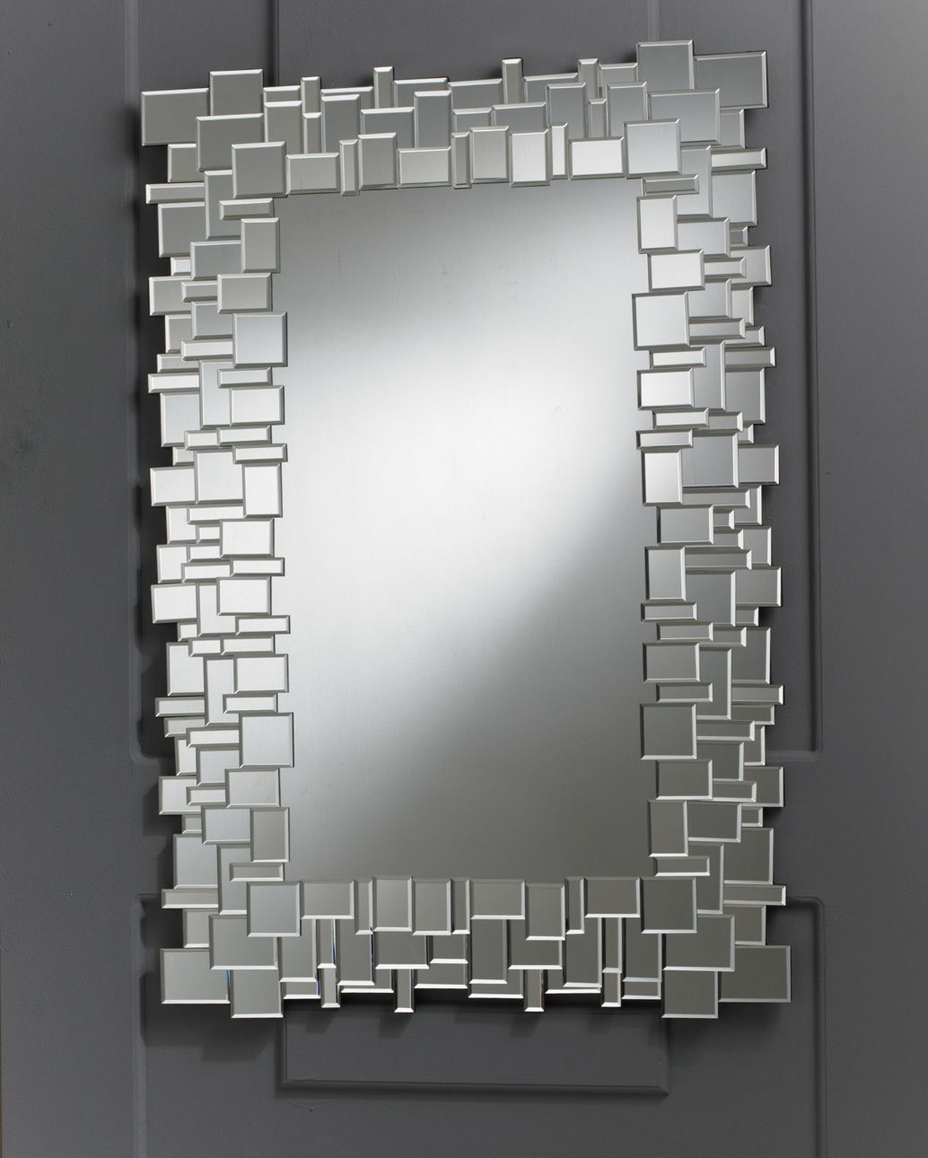 http://www.totalmirrors.com/185-1380-thickbox/pave-multi-facet ... - Adding to the wish list for our Very empty lounge room wall