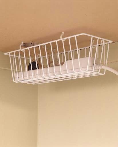 Clever idea. Hang an old freezer basket or similar under your dressing table or desk using cup hooks. Keeps cords and multiplugs off table or surface