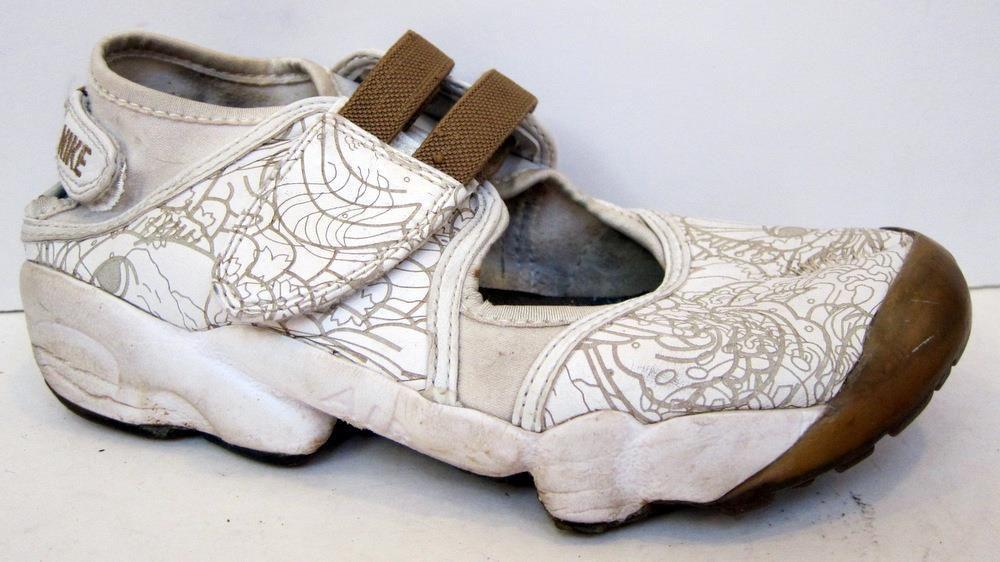 13f0753f50e1f2 NIKE Women s Air Rift White Printed Leather Split Toe Running Shoe Size US  7  Nike  RunningCrossTraining