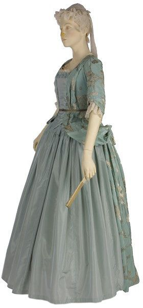 """Mantua  Place of origin: England, Great Britain (made)  Date: ca. 1720 (made)  Materials and Techniques: Silver brocaded silk, lined and faced with silk  Museum number: T.88 to C-1978 """"By the early 18th century, the mantua was worn by women as formal day wear. The pale blue silk of this example is brocaded in silver in a large-scale pattern of fantastic fruits and leaves, a typical design for the 1720s. The train of the gown is folded up and the sides held back with a loop and button."""""""