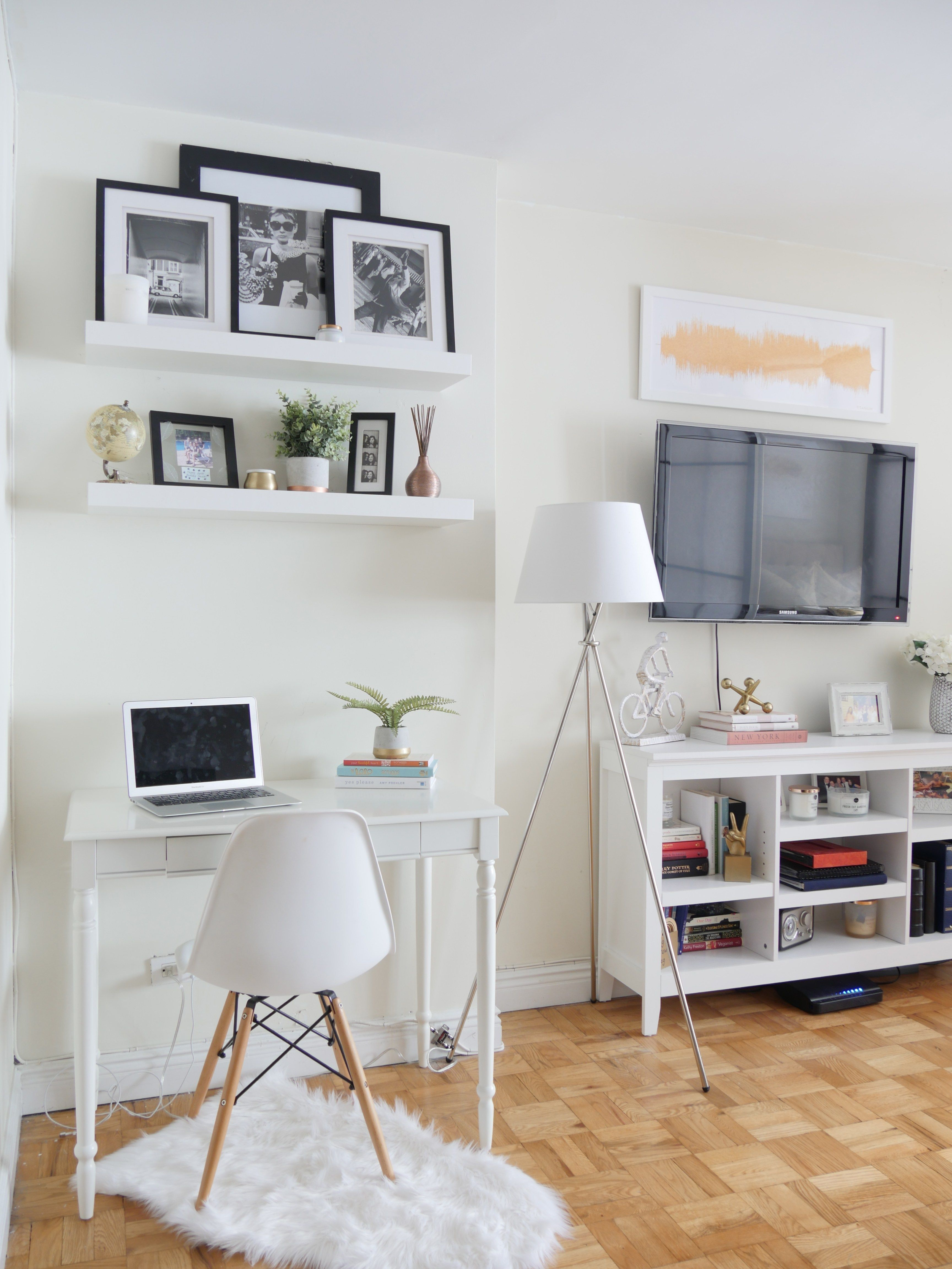 How To Decorate The Walls In Your Rented Space City Chic Decor Apartment Decorating Rental Nyc Studio Apartments Bookshelves In Living Room