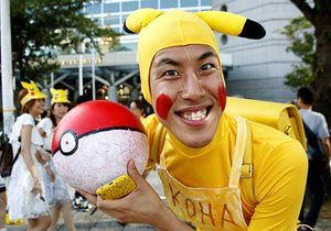 A man dressed as the Pokémon character Pikachu smiles before a parade in Yokohama, Japan