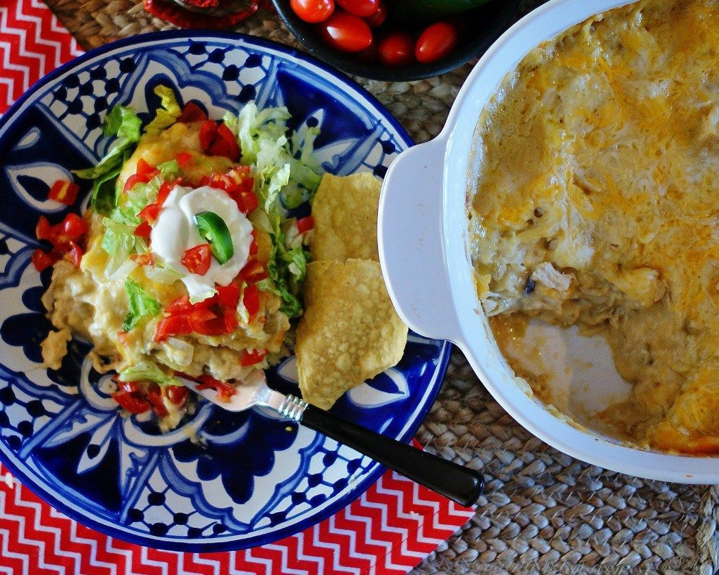 Green Chile Chicken Enchilada Casserole - a southern discourse #todieforchickenenchiladas The joke about married life really just being all about one of you asking What do you want to eat? and the other answering I don't know over and over again until you die is pretty darn accurate. But with this easy Green Chile Chicken Enchilada Casserole? That conversation just got a lot easier! #todieforchickenenchiladas