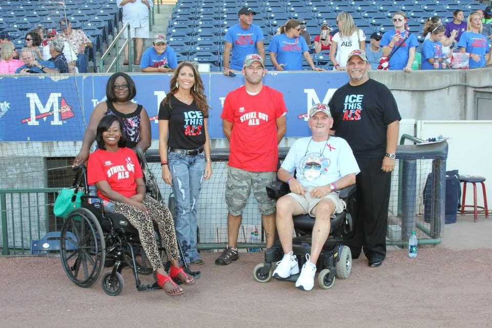 Spreading ALS Awareness at a Mississippi Braves game are Amanda Okidika, Ralph Doxey and Jimmy Roberts pose with Amanda's care giver, ALS Association Care Services Coordinator Brandi Nickles and Braves general manager Steve DeSalvo. Image courtesy of the