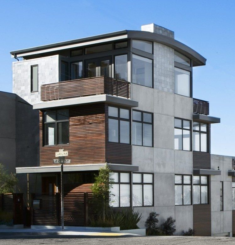 moderne fassade aus dunklem holz und stein balkon. Black Bedroom Furniture Sets. Home Design Ideas