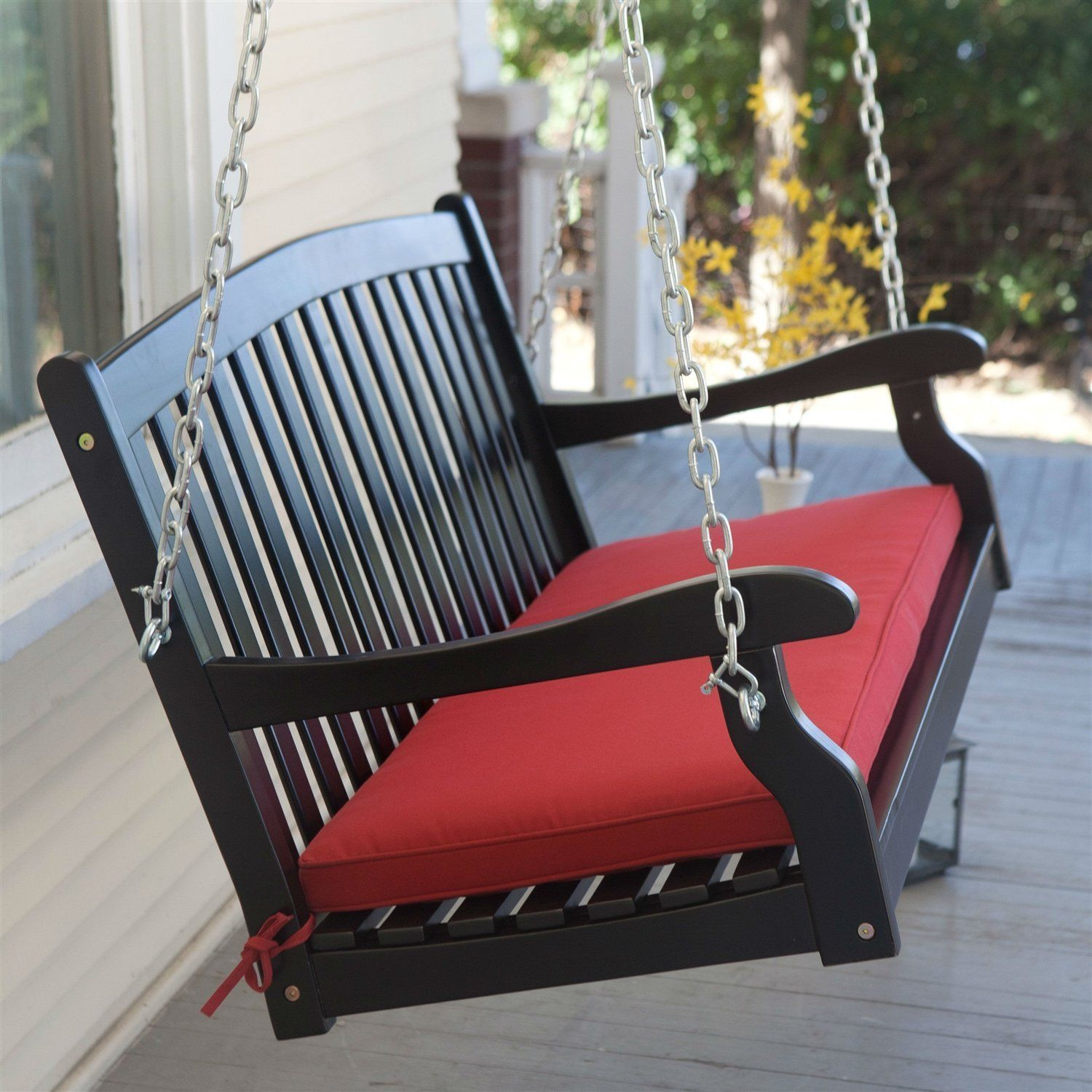 Black 5ft wooden porch swing with brick red cushion and