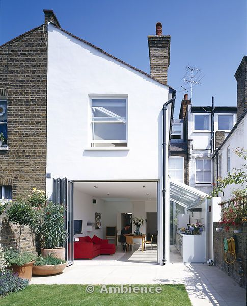 Modern Conversion And Extension Rear View From Garden Patio Gl Lean To Terracotta