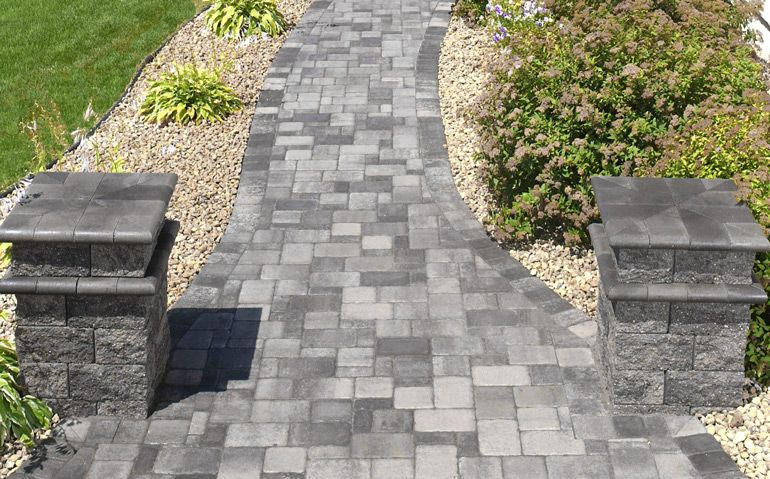 Creative Walkways bullnose-capped columns frame this cobblestone walkway. | creative