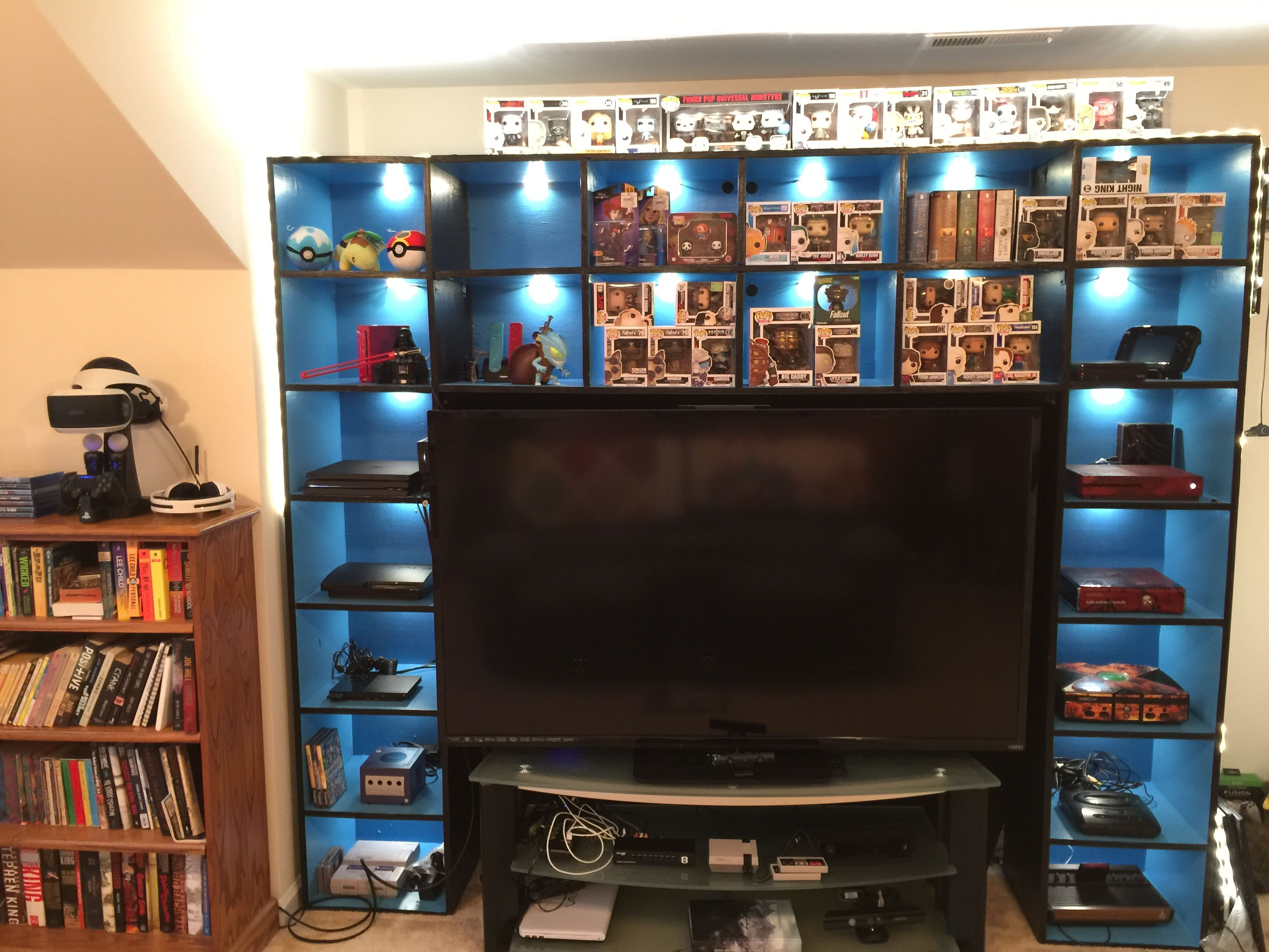 If you have a game room or recreation area in your home, it's important to have good lighting. Video game shelf. Video game room. Video game console ...