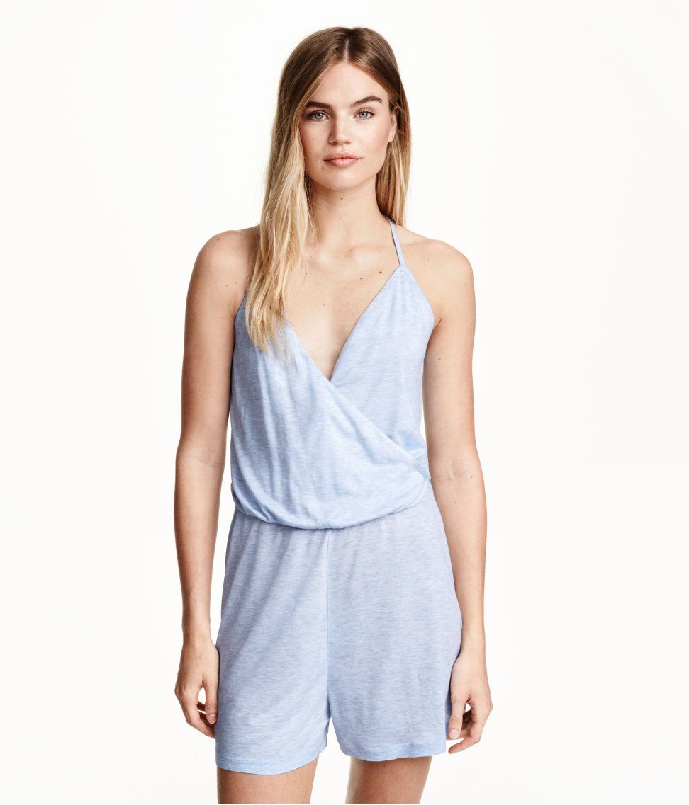 47fa3842a0c This soft blue romper with wrap front   elastic waist.
