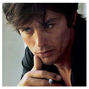 """Alain Delon face of Eau Savage  Alain Delon, one of the male fashion icons featured frequently in this blog, is currently the face of the """"Eau Savage"""" (Dior) campaign. A fragance created in 1966, the year Delon was photographed below by photographer Jean Francois Perrier in St. Tropez."""