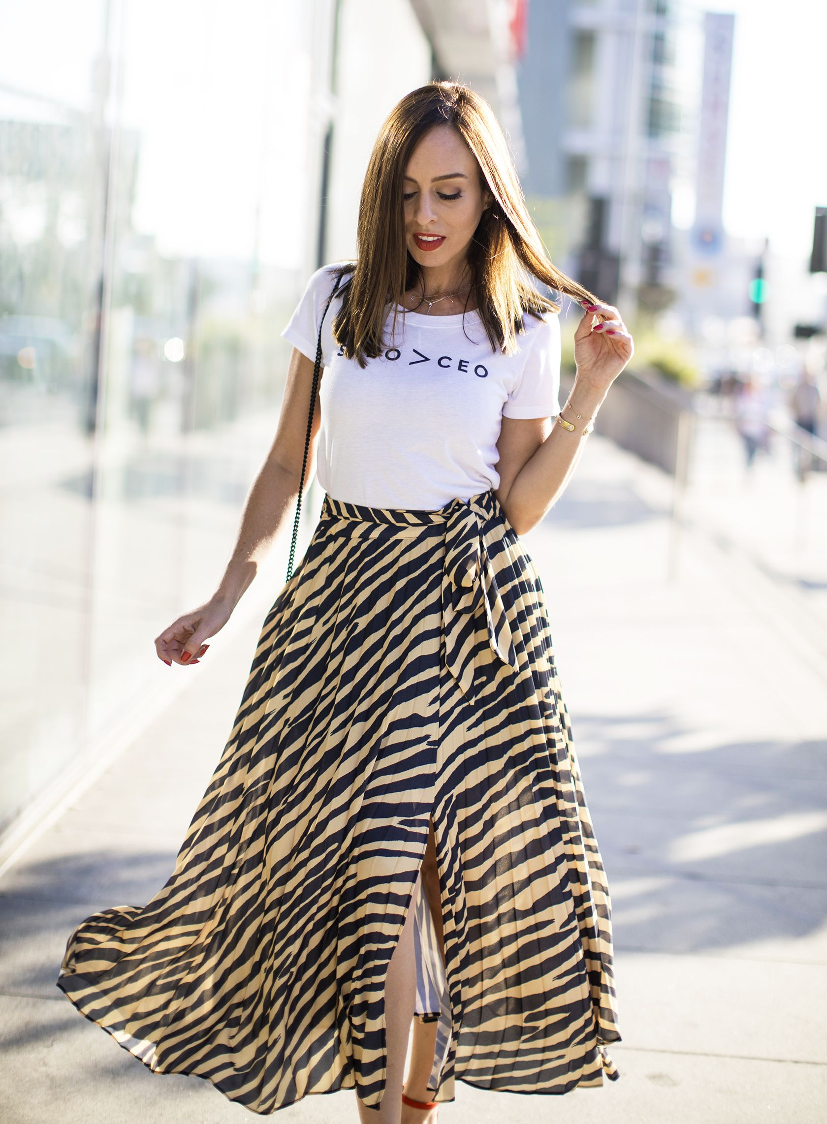 dea29daf7ad Sydne Style shows how to wear animal prints in topshop zebra skirt  zebra   skirts  tees  tshirt  graphictee