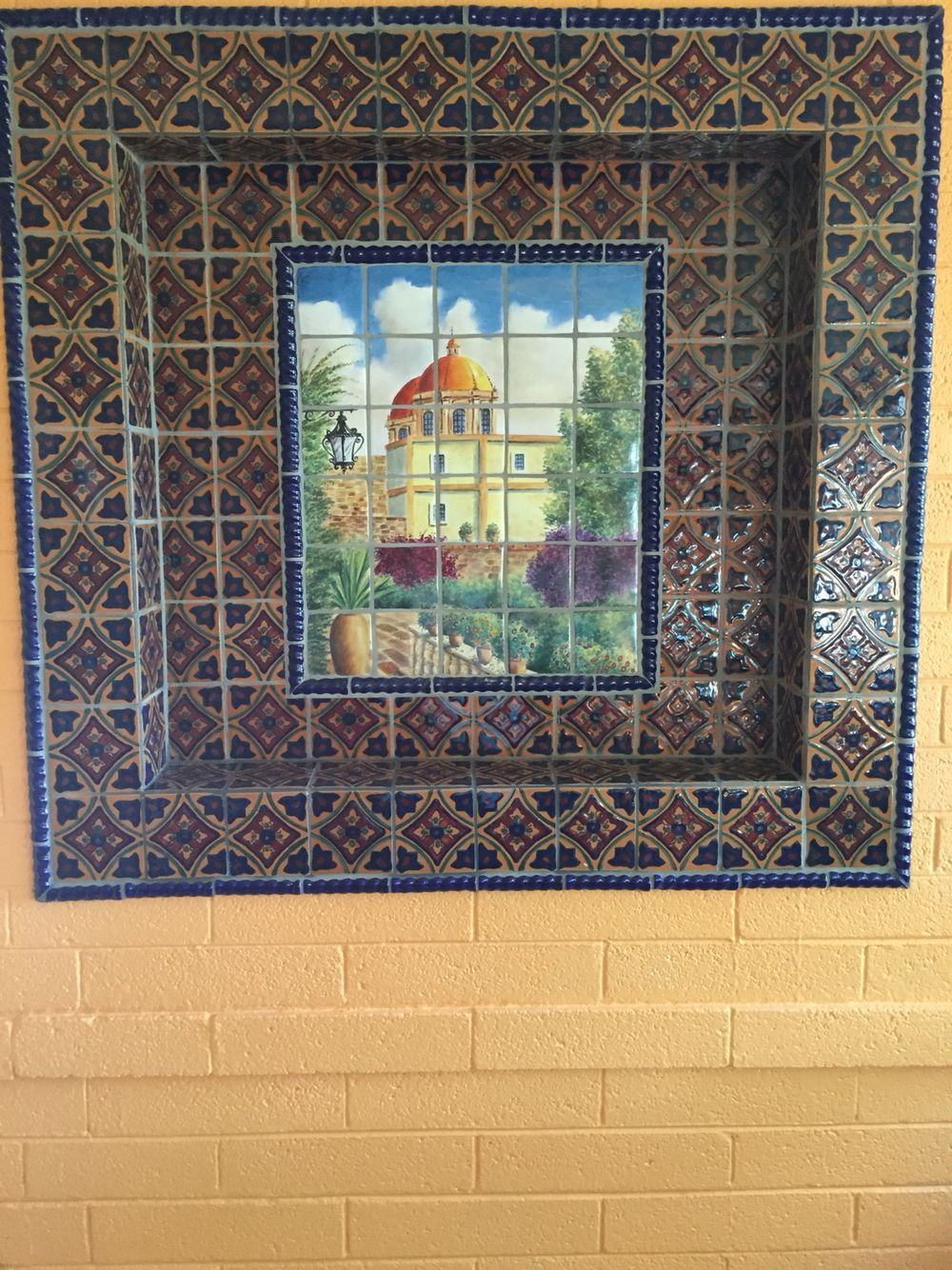 Mexican Tile With A Tile Mural In The Center Of This Niche Tile