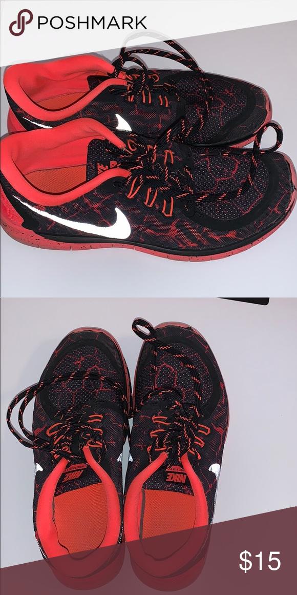 buy popular 62140 7882c Nike free 5.0 Orange and black tennis shoes, lightly worn. Nike Shoes  Sneakers