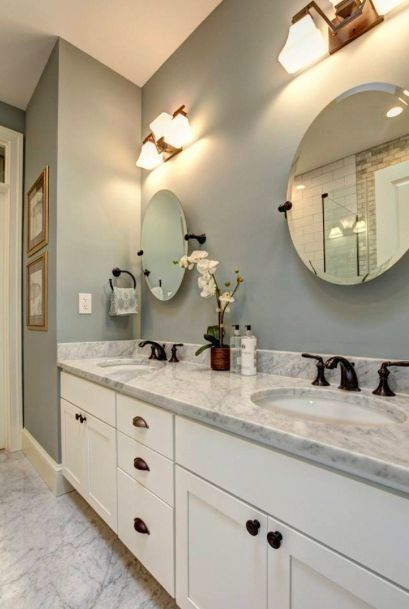 Photo of Master bathroom, subway tiles, marble countertops, lighting, mirrors, oil rubbed in … Master ba …