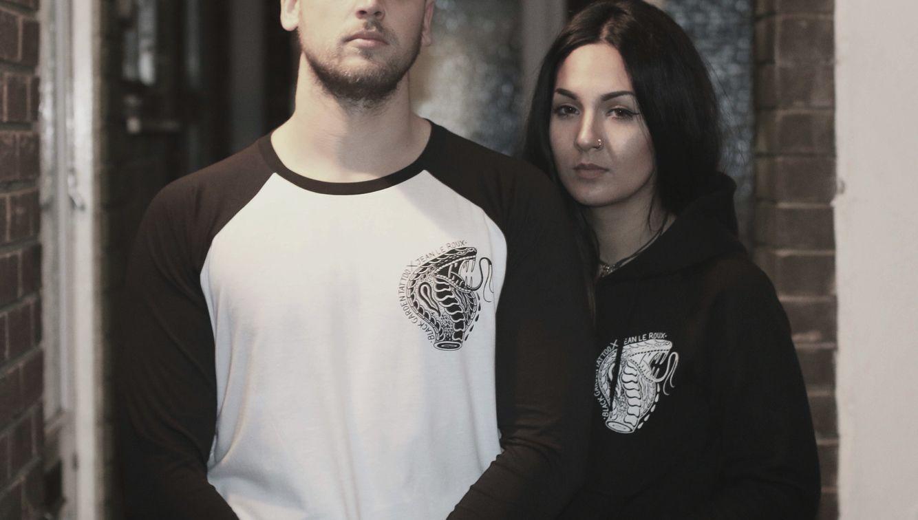 Lewis & Kara wearing our snake charmer set still available at www.thetallon.com  #snake #snaketattoo #tattoo #raglan #hoodie #tee #blackandwhite #tattooflash #thetallonco #london #oldschooltattoo #jeanleroux