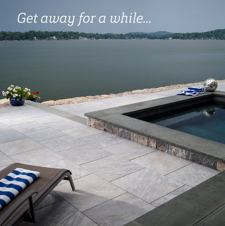 A Beautiful Pool Deck With A Beautiful Pool Consider Using Belgard Porcelain Pavers For Your Next Project Outdoor Patio Patio Pool Pavers