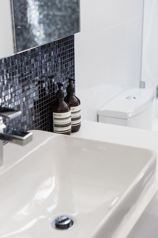 Black glass mosaic tiles, Kohler tapware and Clipsal saturn zen ...