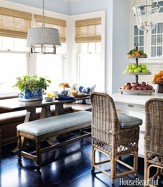 wicker stools, blue & white transferware, white cabinets, natural light from the bay windows, window treatment filtering the light