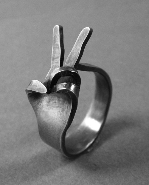 Peace sign ring.