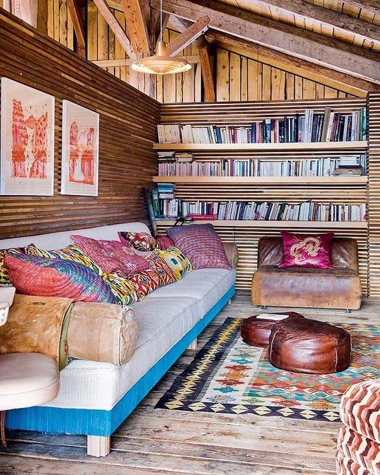 Cosy place to read a book! I love all the eclecticism and the bright busy patterns brighten up the woodsy/rustic feel.