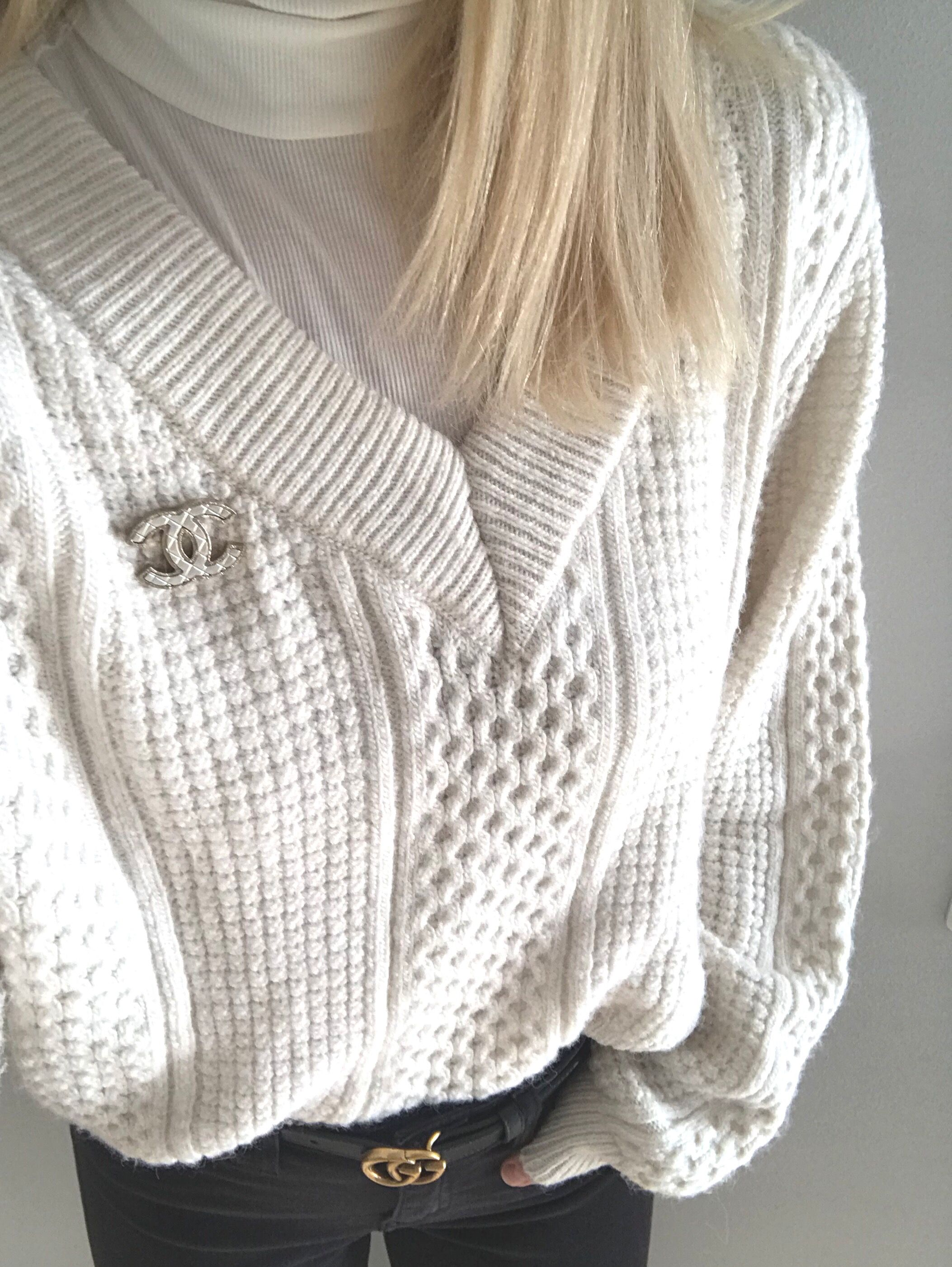 f01cb064225 Chanel brooch and gucci marmont belt with a white knit sweater ...