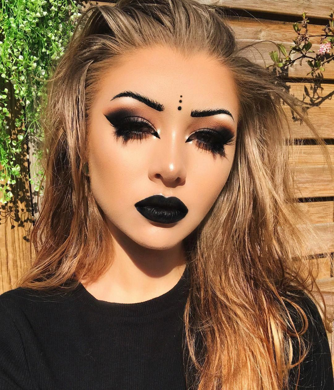 36 Black Lipstick Looks   How to wear black lipstick. -- @sarahanne616 Instagram   She is serving face with this bold black eyeshadow makeup and bold black lipstick. This is definitely a goth makeup look. --- #black #lipstick #blacklipstick #goth #makeup #gothmakeup #gothgirl -- #Estilo