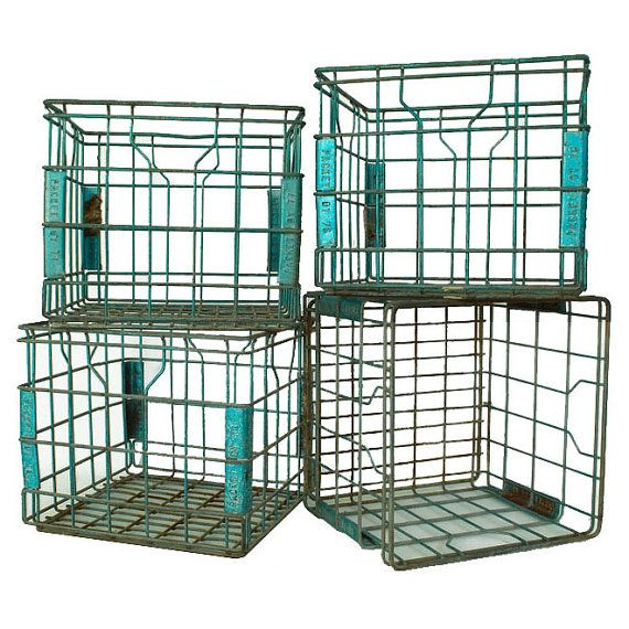 Metal Dairy Milk Crates.  Just bought two of these + one larger one at a flea market for 10.00 - AWESOME!