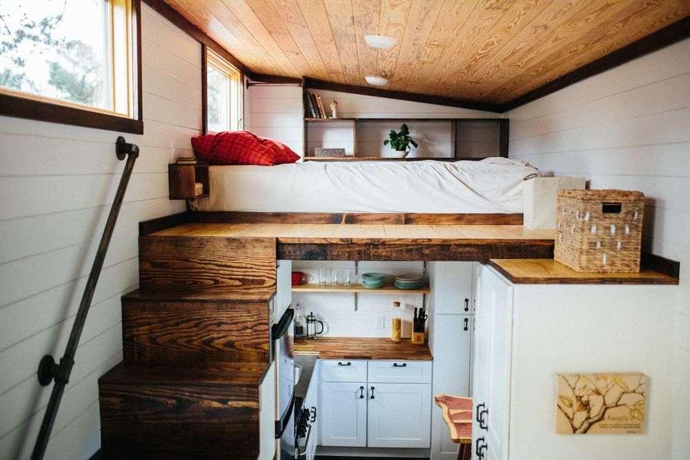 the chimera by wind river tiny homes storage stairs with stained treads up to main loft built in nightside tables welded rod handrail and clothing rail - Tiny Home Storage