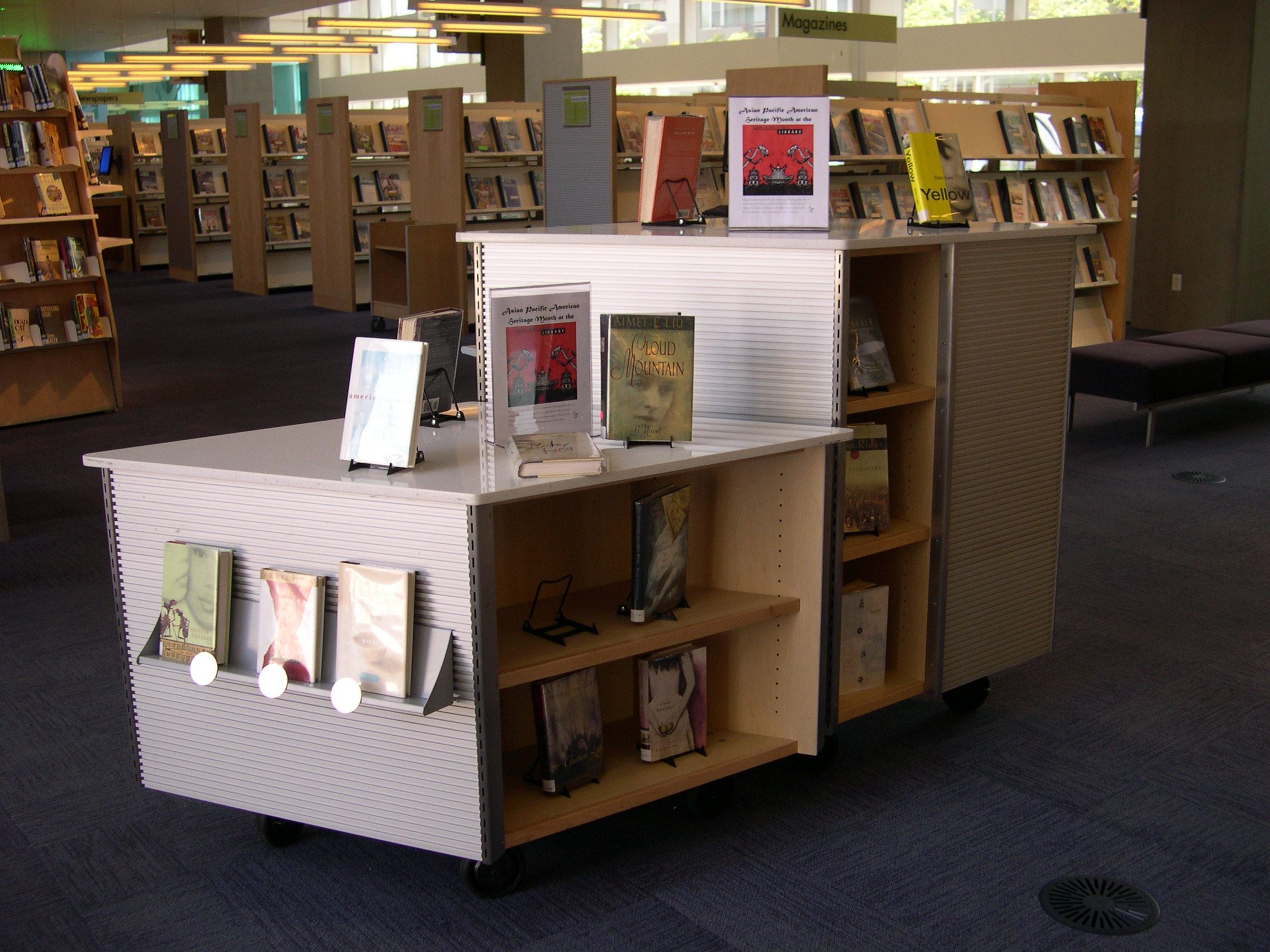 A Movable Book Display Gives You Much More Freedom Within Your Library S Space Library Shelves Space Planning Shelving