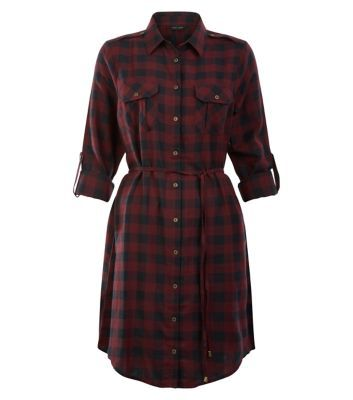 "For casual day looks try this grid check shirt dress with fringe ankle boots and a longline knit.- All over grid check print- Collared neck- Button front fastening- Double pocket front- Rolled sleeves- Tie waist- Mini length- Soft cotton fabric- Model is 5'8""/176cm and wears UK 10/EU 38/US 6"