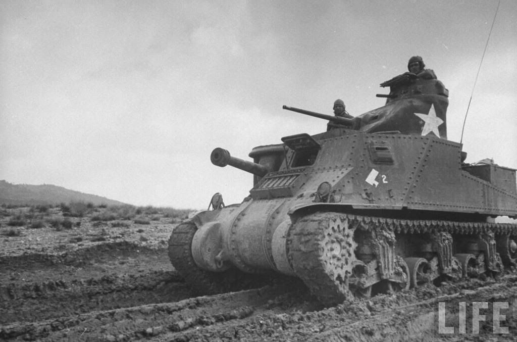 american m3 grant tank churning through thick mud during the north african campaign location
