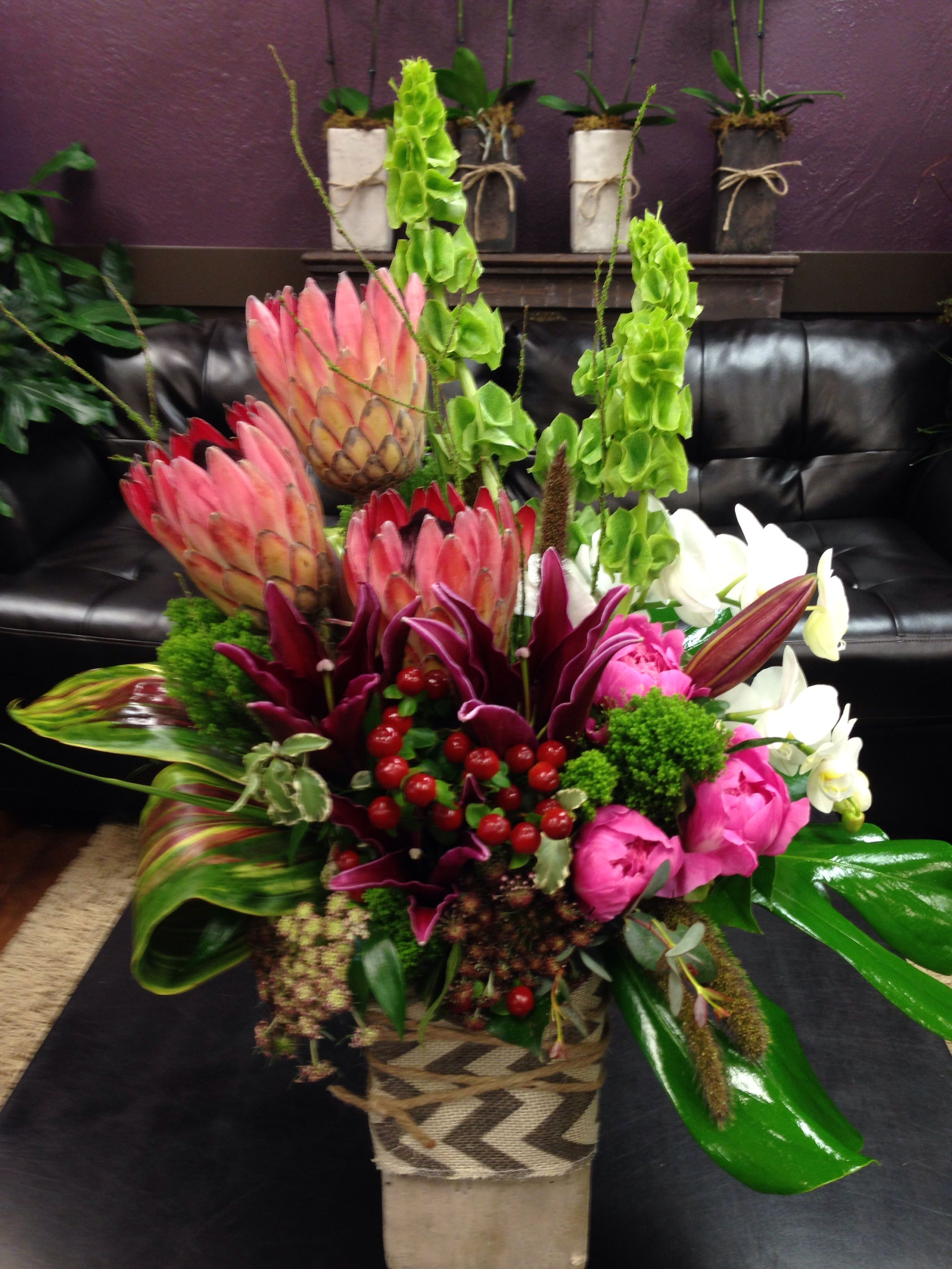 Tropical Floral Arrangement With Protea Orchids Peonies Belles Of Irelan Tropical Floral Arrangements Large Flower Arrangements Tropical Flower Arrangements