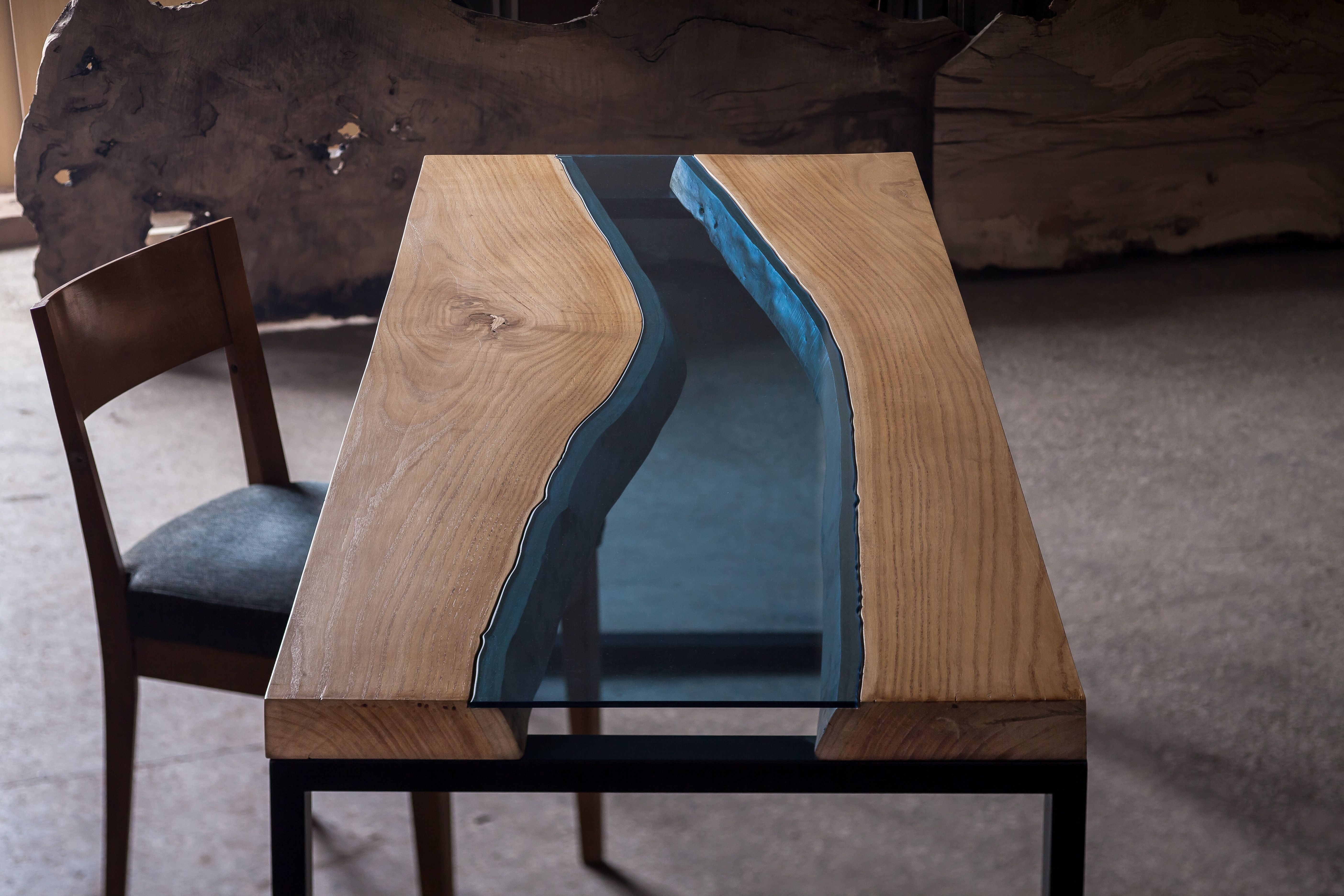 Aqua dining table made from oak tree and blue glass Available
