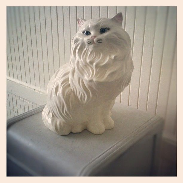 my meemaw had this same persian cat statue in her living room for as