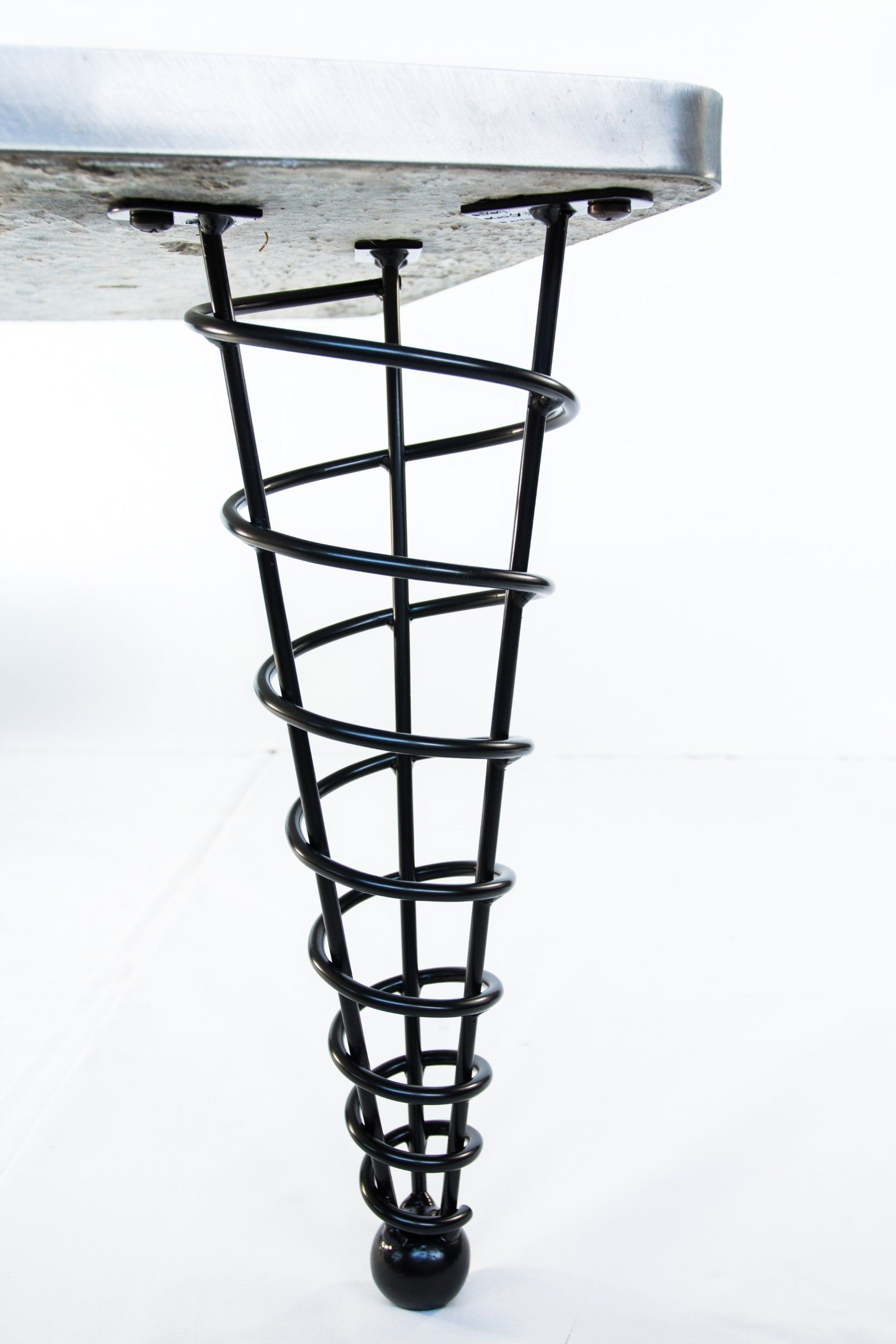 Bench or Coffee Table Legs, Unique Handmade, 16-inch Height, Set of Four. These striking modern table legs grew from a dinner napkin sketch, and are made with our own hands. They are made of 1/4-inch cold steel round bar, formed and welded into a spiral cone, ending at a 1-1/2-inch diameter solid steel ball. They are very sturdy legs and can support a heavy table. Powder coated semi gloss black suitable for indoor or outdoor use. Set of four table legs.